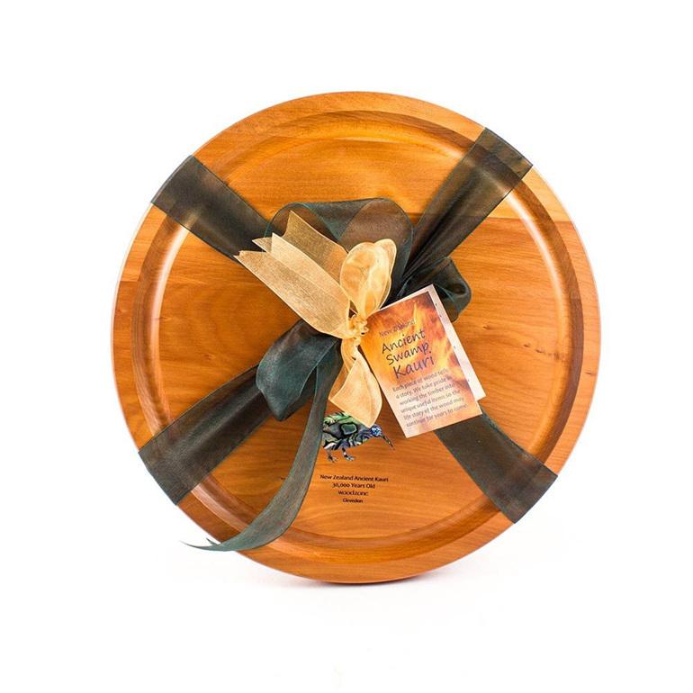 round cheese board with paua kiwi and ribbon