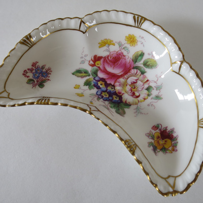 Small crescent shaped dish
