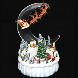 Santa Flying over Moving Snow Village - Ornament