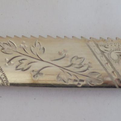 Engraved scone knife