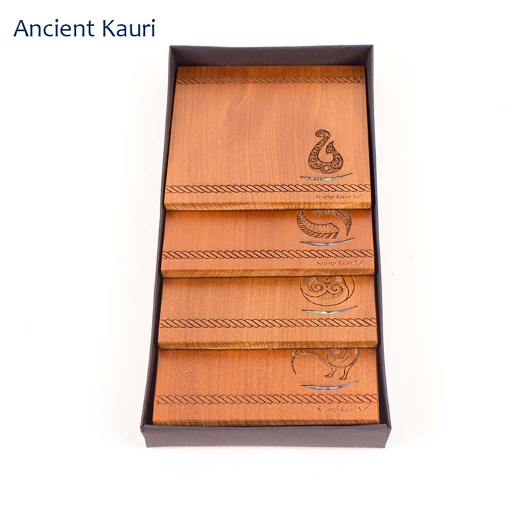 set of 4 coasters with engraved icons - ancient kauri - new zealand made