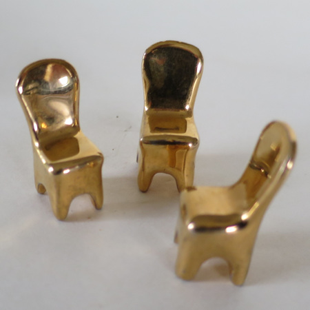 Set of three gold chairs