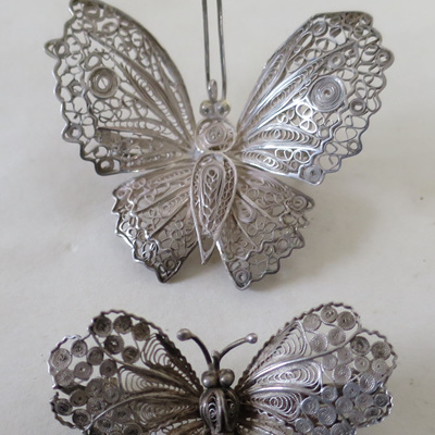 Filigree butterfly brooches