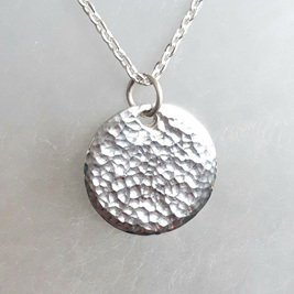 Silver Pendant with Sparkling Hammered Texture