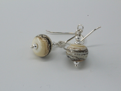 Silvered ivory earrings - on ivory