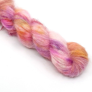 skein of brushed suri alpaca and silk in cream, pinks and golden yellow tones