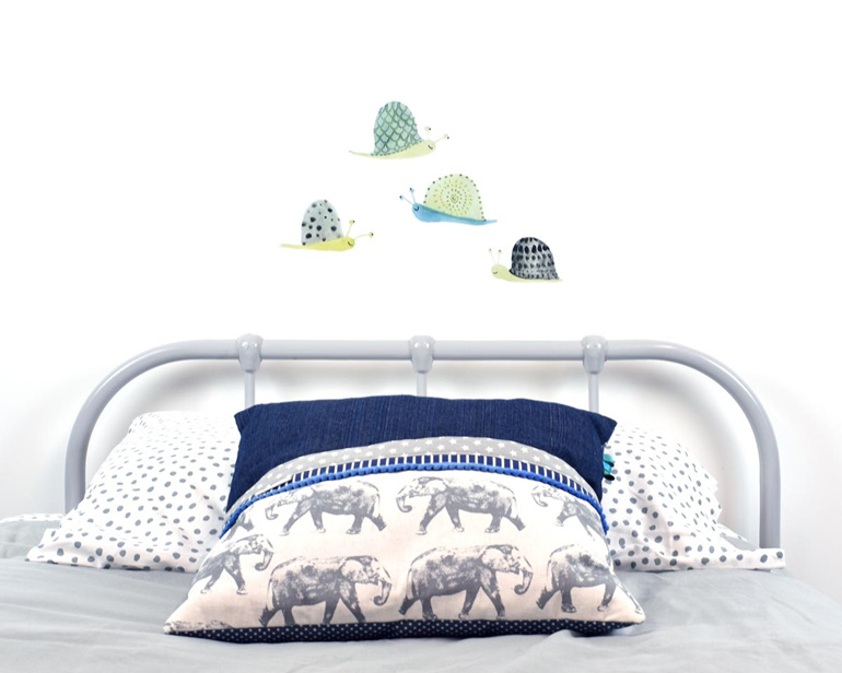 Snail wall decal with elephant cushion