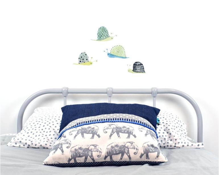 Snail wall decal with elephant cushion