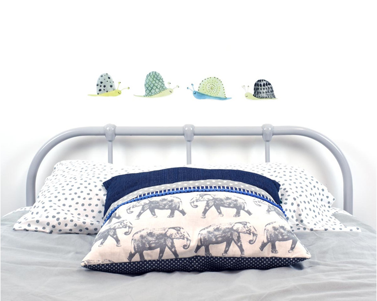 Snail wall decals in line with elephant cushion