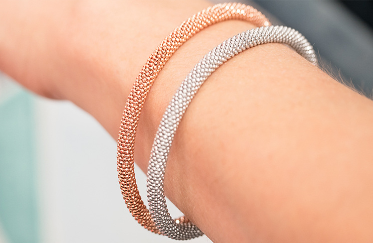 Sterling Silver and Rose Gold Plated Magnetic Bracelets on Hand