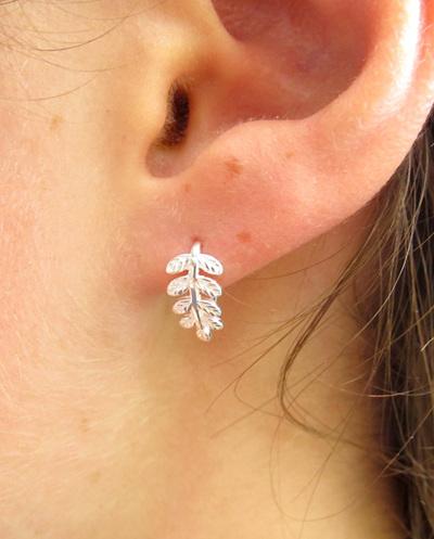Curled silver fern stud earrings
