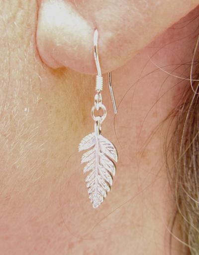 Silver fern drop earrings