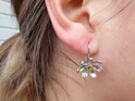 Sterling silver NZ Clematis drop earrings on our model - they look amazing!