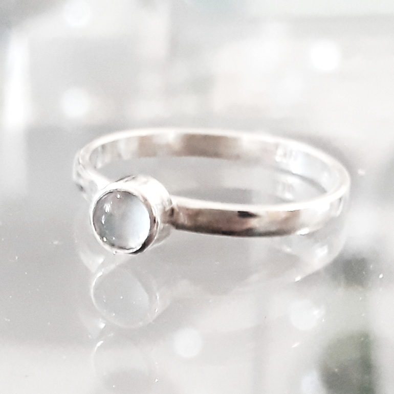 Sterling silver ring with opal cabochon