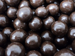 strong dark chocolate, crisp kernel, panned