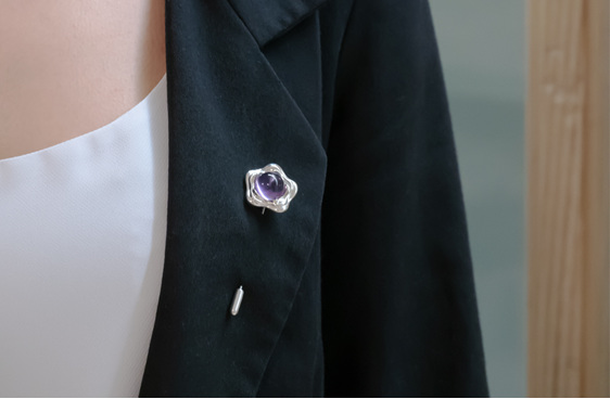 Suffrage 125 silver & amethyst pin by The Village Goldsmith & Te Puna Foundation