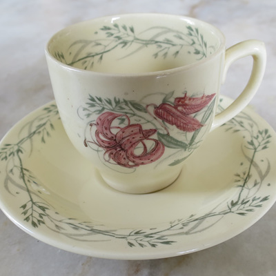 Coffee can and saucer in Tiger Lily pattern