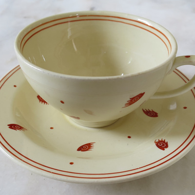 Cool cream and burgundy pattern on cup and saucer