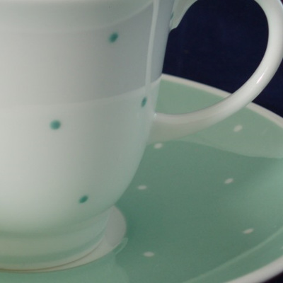 Susie Cooper pastel green raised spots coffee can and saucer