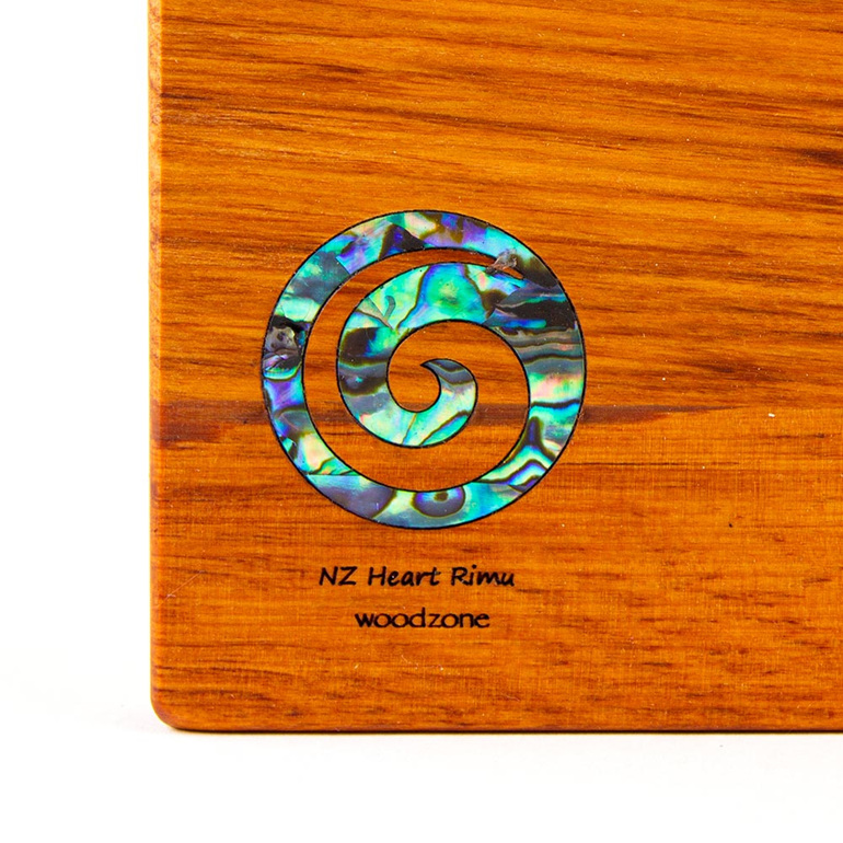 the great nz cheese board with Paua Koru - heart rimu - detail