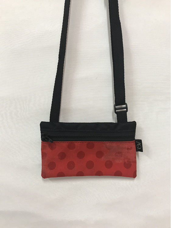 The small Dory handbag in bright red dots.  Walking women will love this!