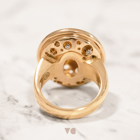 The underside of the yellow sapphire ring - diamonds set in white gold holes