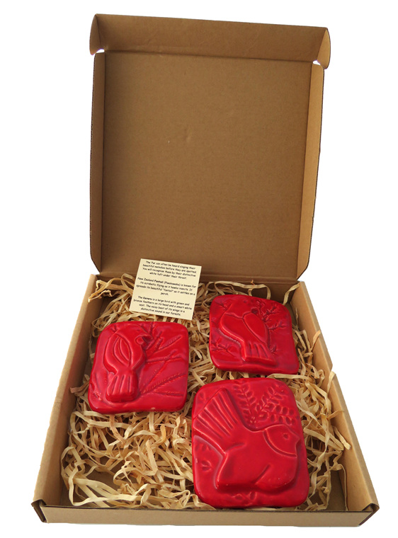Three little red ceramic birds in a box by Hasina Art