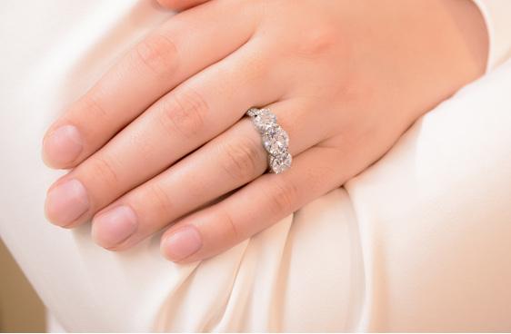 three stone detailed diamond engagement ring, platinum