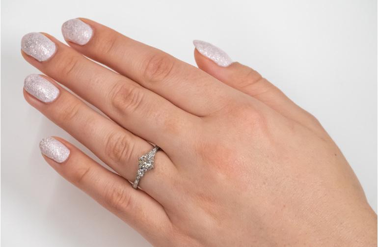 Three stone diamond engagement ring on hand celtic inspired design milgrain