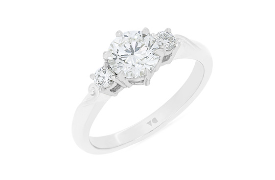 Three stone diamond engagement ring with koru detail in band 18ct gold platinum