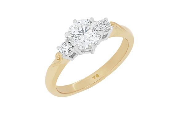 Three stone diamond engagement ring with koru detailing in band 18ct gold