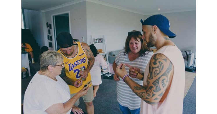 TJ Perenara with cousin Byron, mother and grandmother, showing off their rings