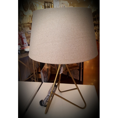Tripod lamp in antique brass finish with tapered drum shade