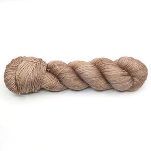 twisted skein of merino silk yarn in a light caramel brown tone