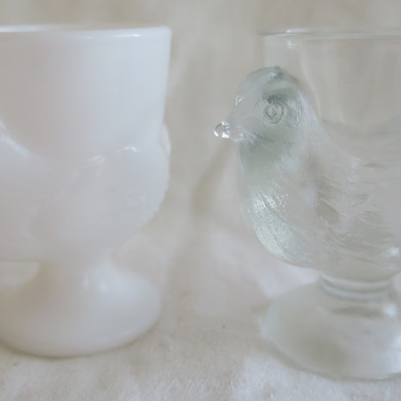 Two glass chickens
