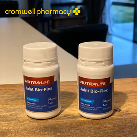 Two pottles of Joint Bio-Flex sitting on a wooden surface with Cromwell logo