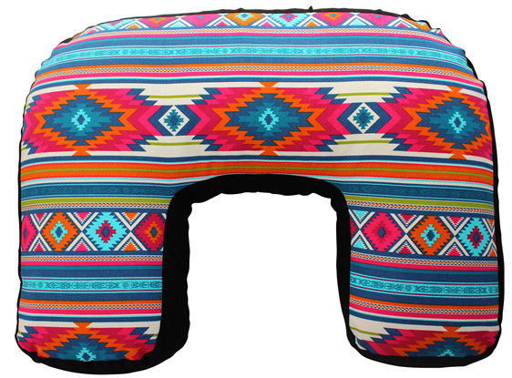 U shaped nursing pillow with a vibrant pink and blue boho inspired cotton cover