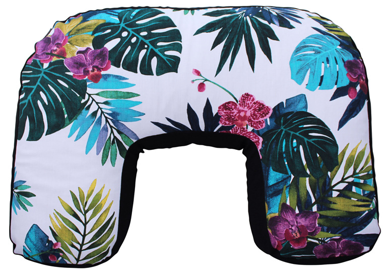 U shaped nursing pillow with beautiful tropical orchids and leaves on it