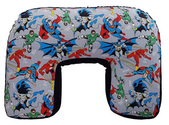 U shaped nursing pillow with Flash, Batman and the green lantern on the cover