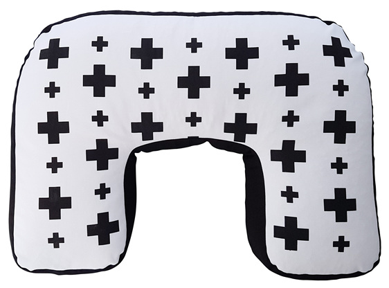 U shaped nursing pillow with hand printed black crosses on it