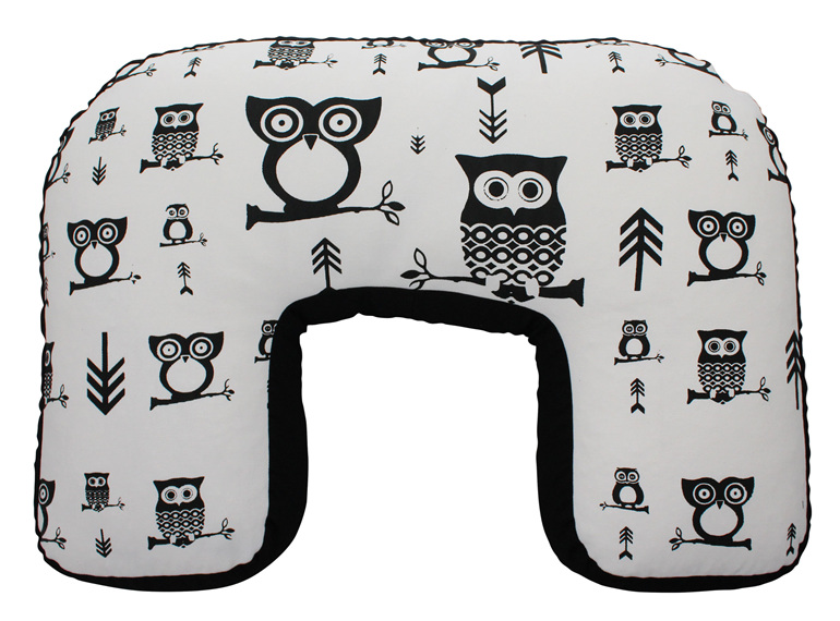 U shaped nursing pillow with hand printed owls and arrows on it