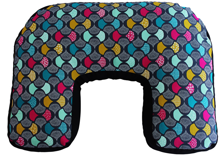 U shaped nursing pillow with pink, teal, mustard, and charcoal scallop print