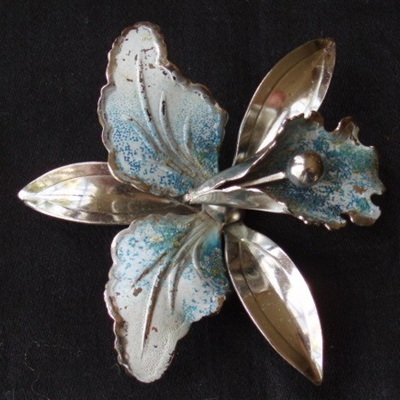 Unsigned silver and blue orchid brooch