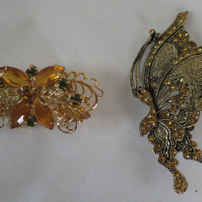 Yellow tone brooches