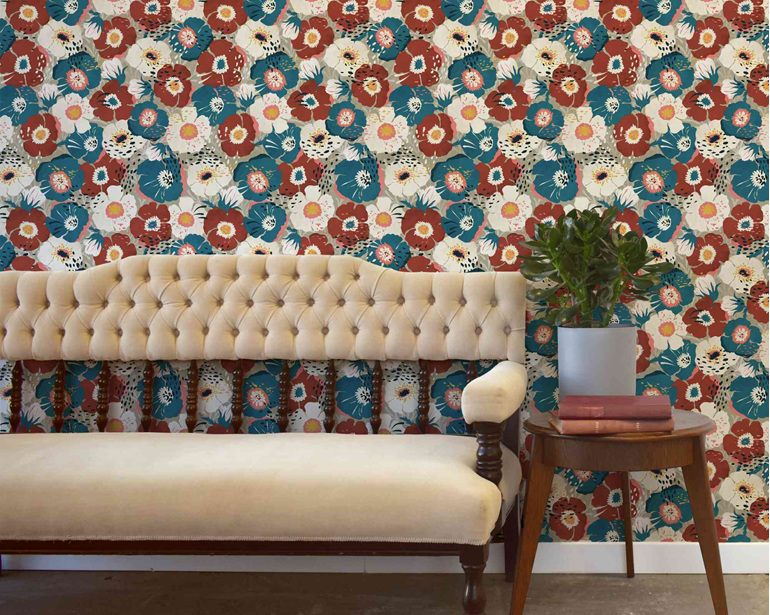 Vintage floral wallpaper with velvet couch, side table and plant