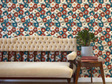 Vintage floral wallpaper with velvet couch, table and plant