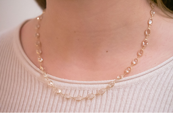 white topaz oval gemstone necklace in 18ct yellow gold