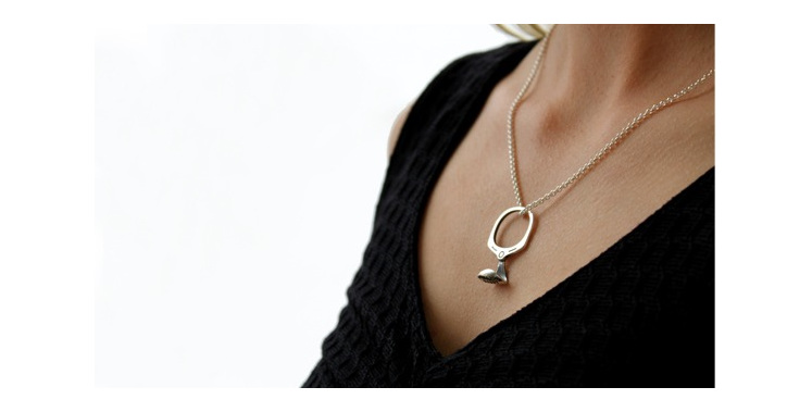 Wilshi Tear Tab Proposal Ring on sterling silver necklace