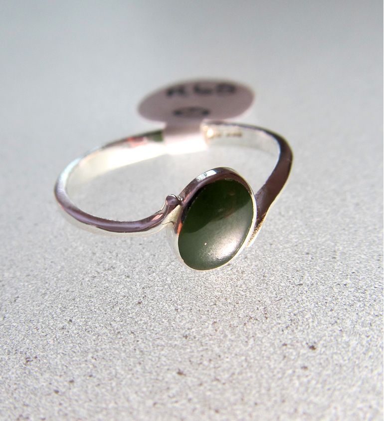 Women's oval greenstone sterling silver ring.