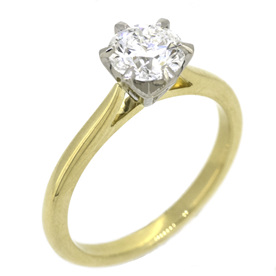 Yellow gold and platinum round brilliant diamond solitaire engagement ring